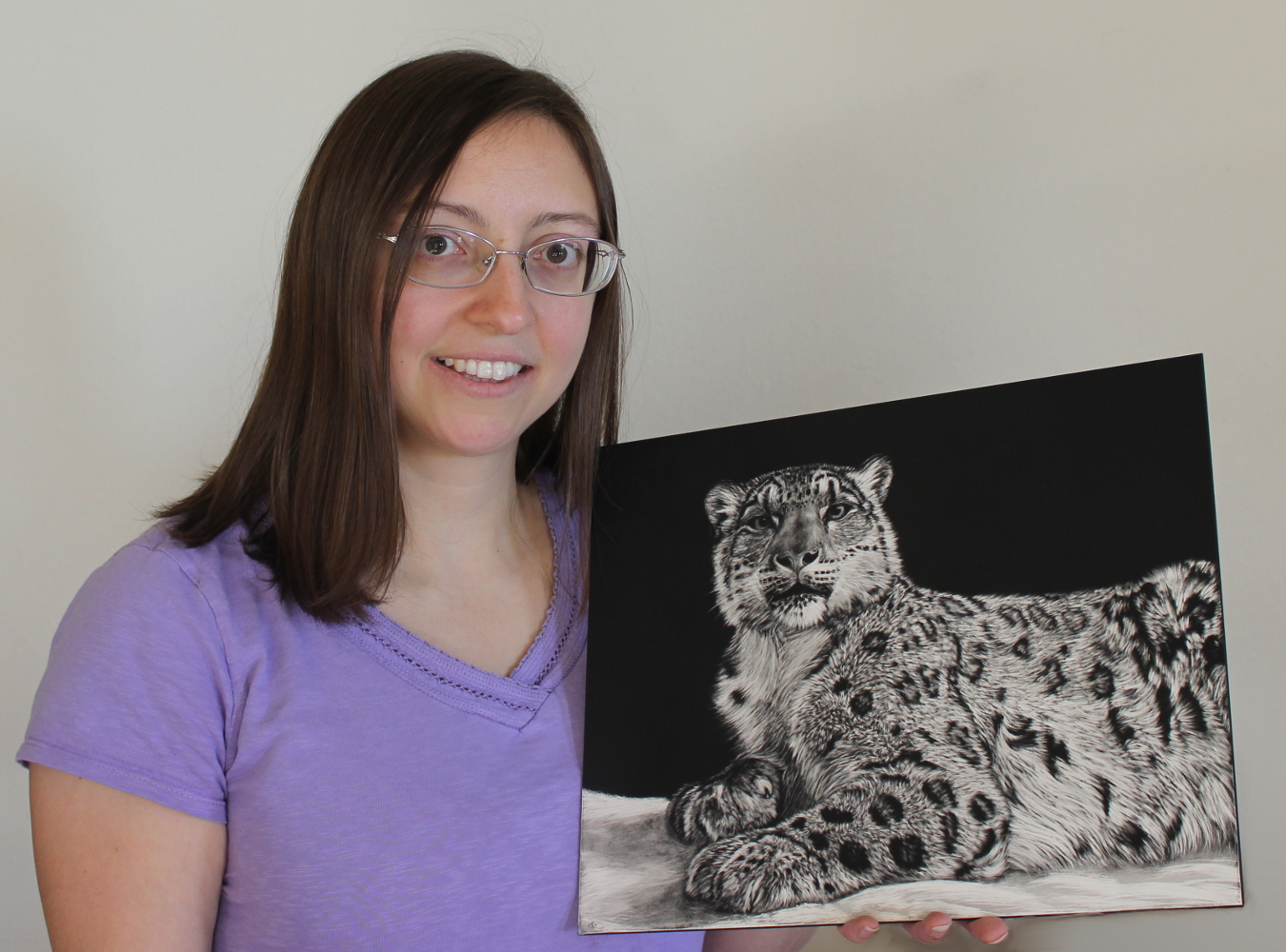 Heather Ward with a scratchboard drawing